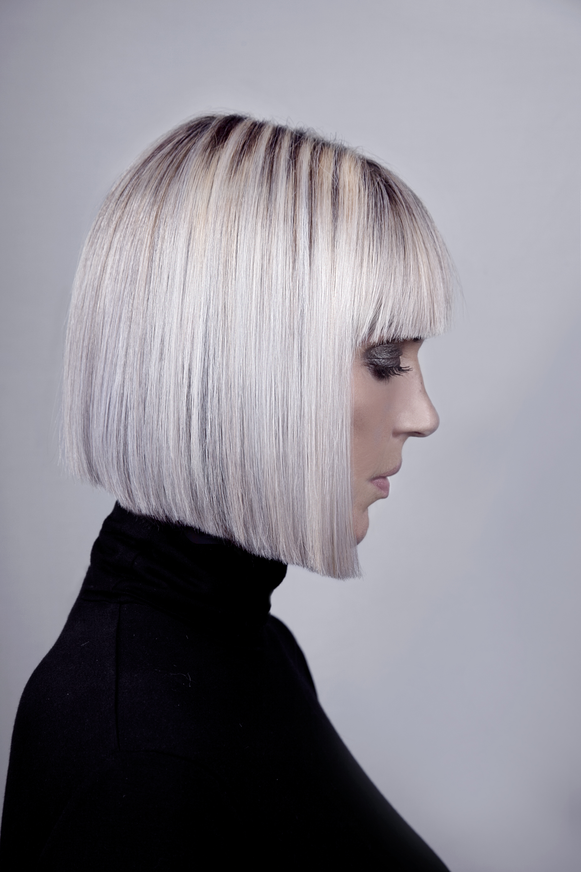 Velvet Rooms sharp platinum bobbed hair style